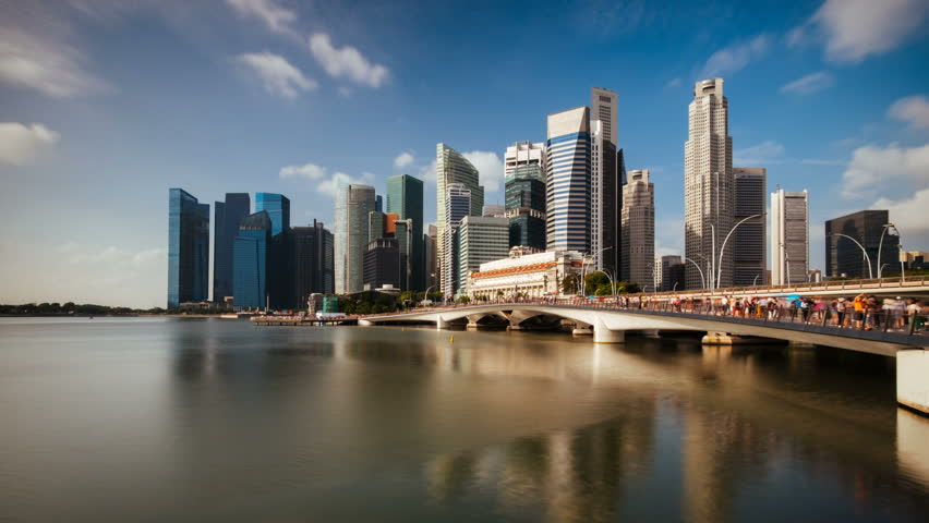 Timelapse of Singapore City Skyline and Financial district across Marina Bay under a beautiful blue sky in Singapore
