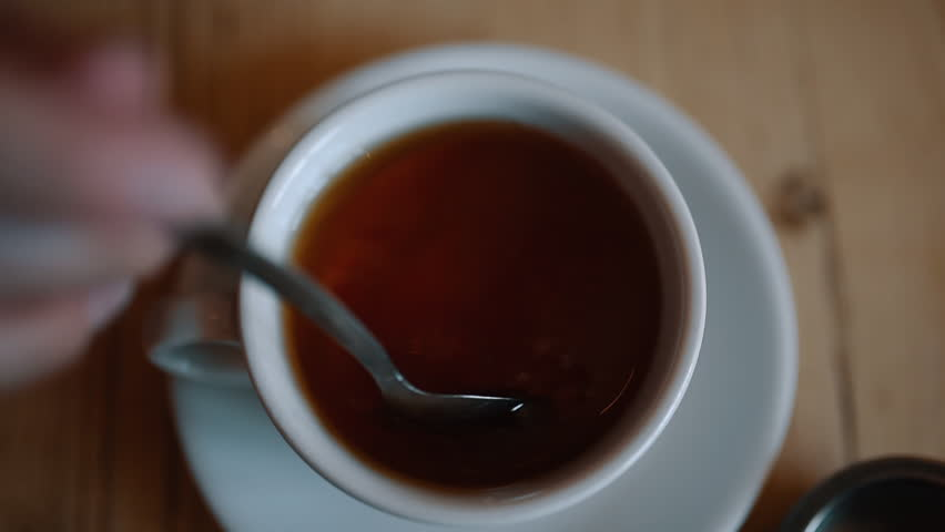 A Cup of Tea being Stirred