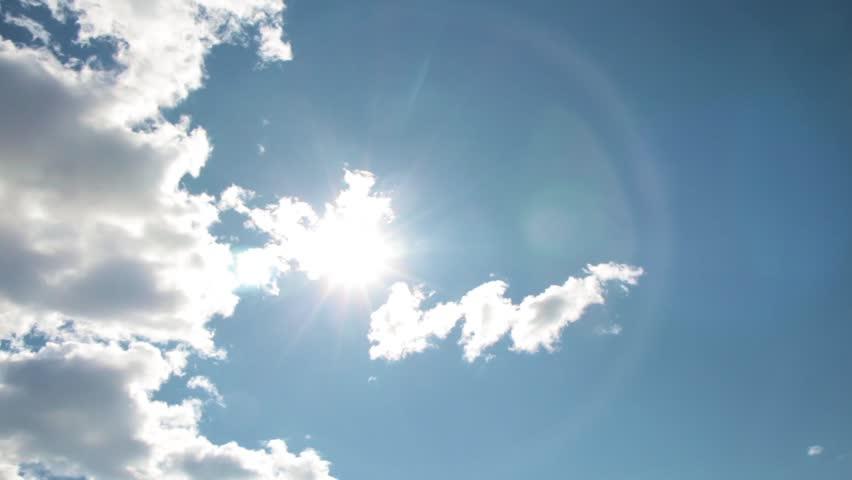 Timelapse White Boiling Clouds Bright Sun Blue Sky    Shutterstock HD Video #1007685715