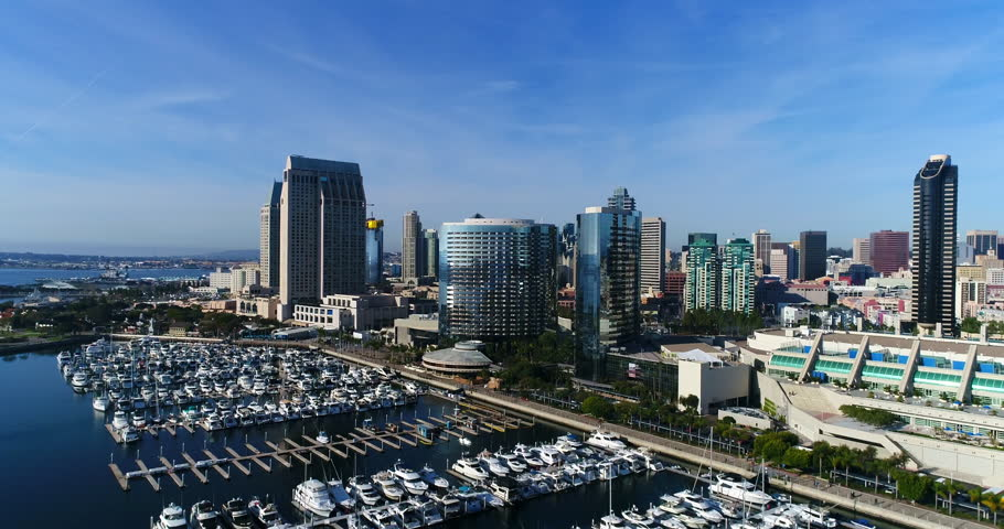 Aerial Drone video flying over the Downtown San Diego Marina with the Embarcadero and the San Diego Skyline. in the background.