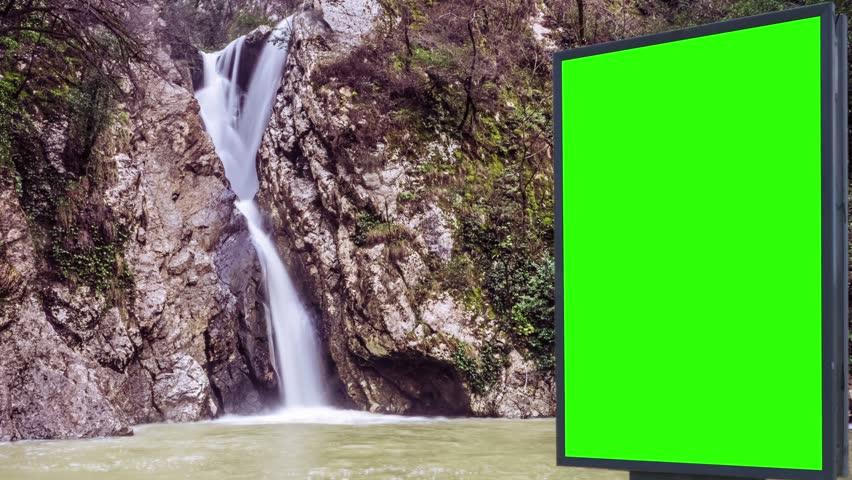 Billboard green screen near the Fabulous waterfall   Shutterstock HD Video #1007704000