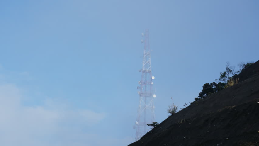 Communications Tower With Cloud Time Lapse on the hill | Shutterstock HD Video #1007708059