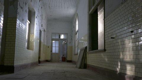 POV of insane person dreamlike spinning in asylum corridor