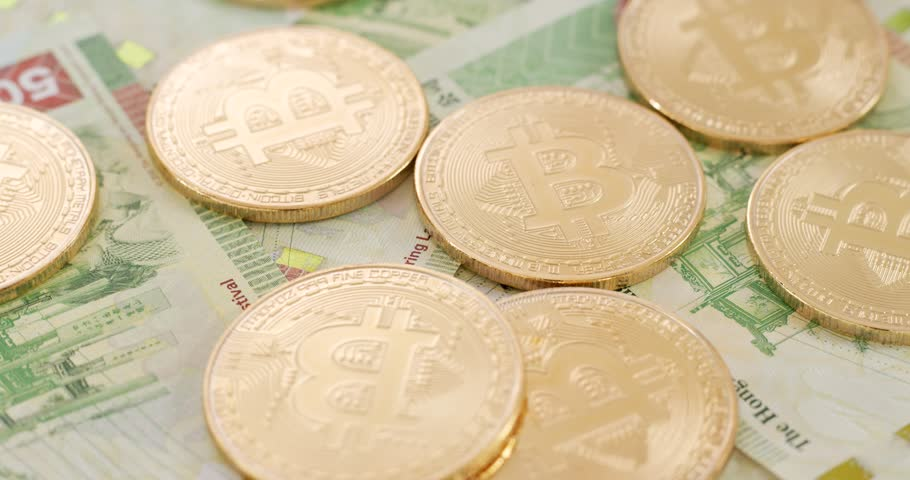 Hong Kong banknote and bitcoin in rotation   Shutterstock HD Video #1007738914
