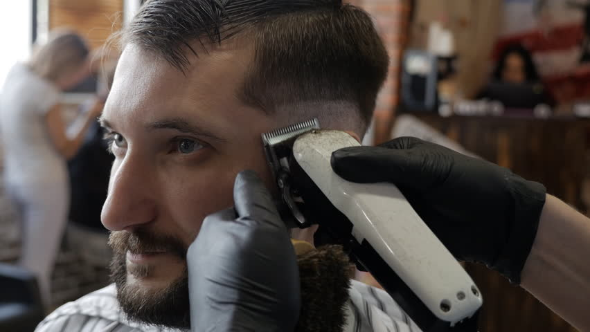 Man hands grooming man hair in barber shop | Shutterstock HD Video #1007741755