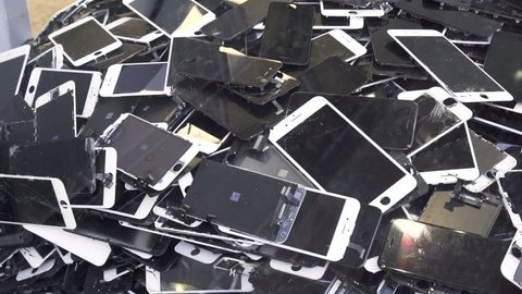 Prague, CZ 21 February 2018: A heap with the broken screens  lying one on top of another. Devices are prepared for utilization.  Editorial