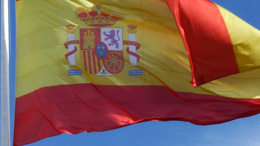 flag of Spain waving in the Plaza de Colón in Madrid, Spain. Filmed on February 20, 2018.