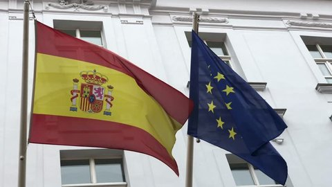 Flag of Spain and EU waving in the wind on the embassy building in Bratislava, Slovakia