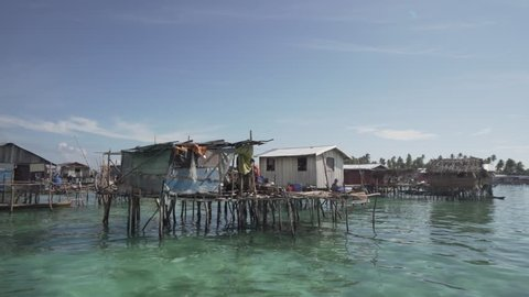 SEMPORNA, MALAYSIA - FEB 18, 2018 : Bajau people livestyles and their are living in the open sea. The tribe are sea gypsies living in open sea with no school & medical care.