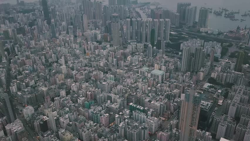 Flying over Hong Kong Kowloon City in a foggy day