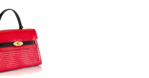 cb0bc3d6b8f6 4K stop motion of red women s handbag moving from left to the center of the  frame