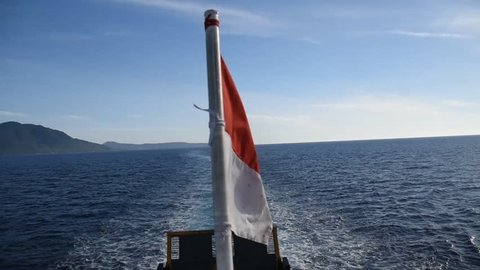 Indonesian flag waving on boat