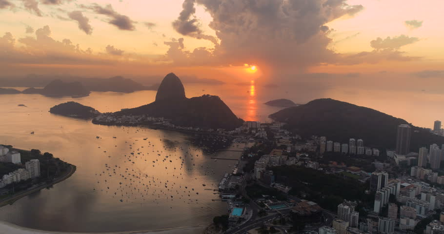 Aerial view of Botafogo Bay and Sugarloaf Mountain at sunrise. Rio de Janeiro, Brazil. Reflection of the rising sun on water | Shutterstock HD Video #1007918725