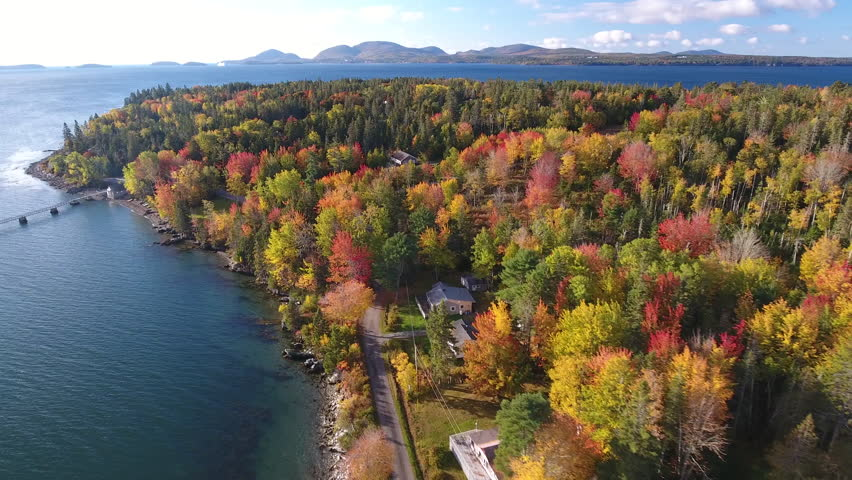 A breathtaking aerial view of Hancock, Maine looking across Mt Desert Narrows to Acadia National Park with the Fall colors in their peak. USA | Shutterstock HD Video #1007928985