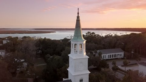 circling aerial view of historic church at sunset in Beaufort, South Carolina.