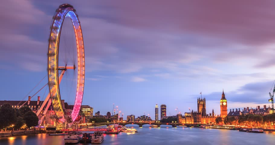 Time lapse of London at twilight from day to night. London eye, County Hall, Westminster Bridge, Big Ben and Houses of Parliament.
