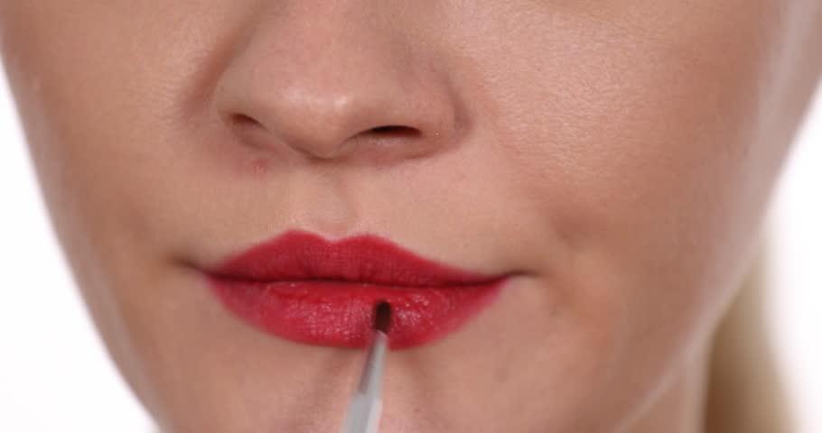 Macro Shot of Woman Make Up Mouth Lips Applying Gloss Lipstick with Paint Brush