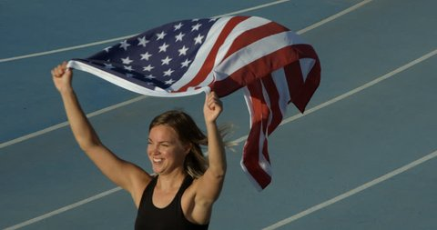 An Athlete Celebrates with the National Flag of the United States of America.