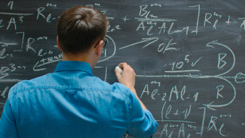 Following Close-up Shot of the Hand Holding Chalk and Writes Complex Mathematical Formula/ Equation on the Blackboard. Shot on RED EPIC-W 8K Helium Cinema Camera.