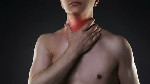 Cinemagraph:  Sore throat, men with pain in neck, black background, studio shot