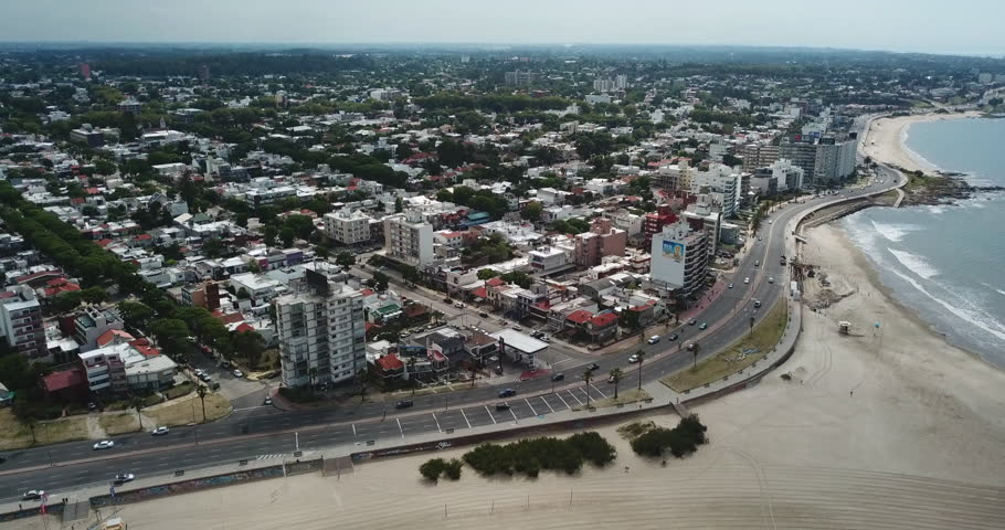 Aerial timelapse- Over beach and city coast in Montevideo - Uruguay