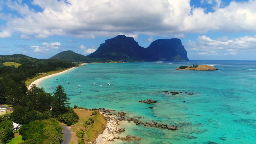Aerial view of Lord Howe Island (World Heritage-listed paradise), turquoise blue lagoon and Mount Gower on background - New South Wales - Tasman Sea - Australia from above, 4k UHD | Shutterstock HD Video #1008122605