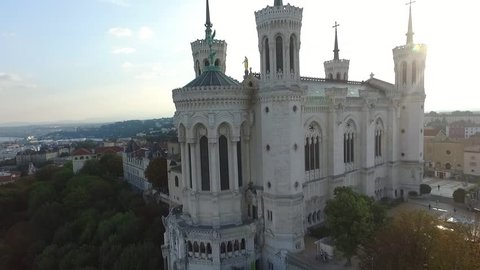 Aerial drone view of the city of Lyon in France with The Fourviere hill and the Basilica of Notre-Dame de Fourviere. / Images de drone de la Basilique Notre-Dame de Fourviere a Lyon.
