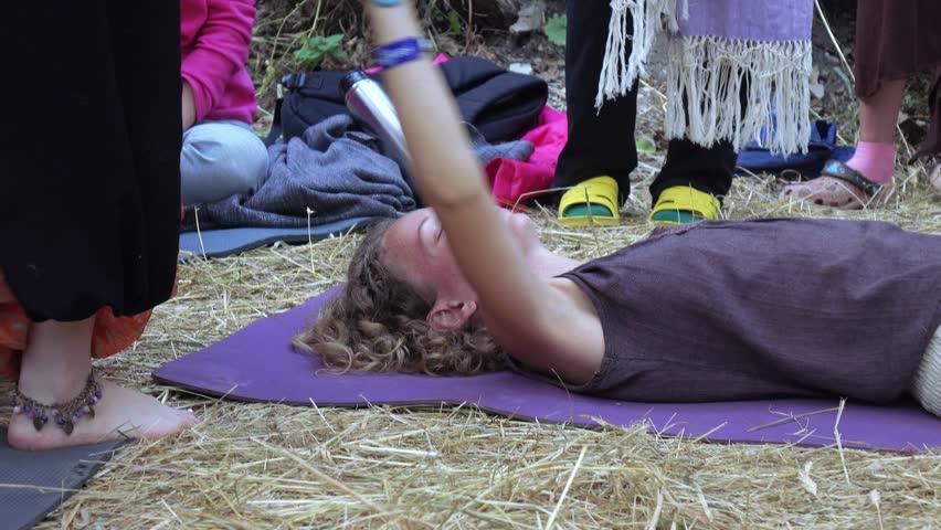 RUSSIA, ABRAU - JUNE 20, 2017: Zifa Ostashko doing Rebzo-massage. Ethno-esoteric Festival of Kwammanga, June 20, 2017 in Abrau, Russia