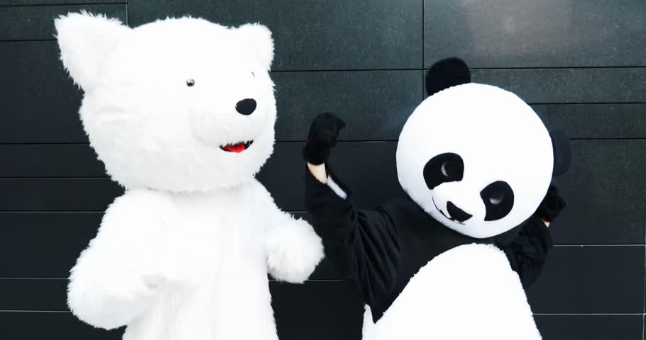 Two friends wearing animal costumes walking and having fun in the city | Shutterstock HD Video #1008154435