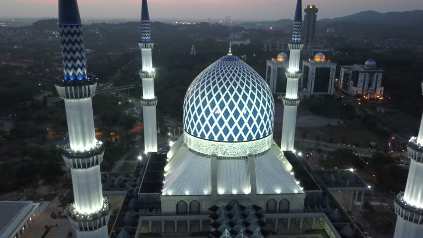4K aerial footage at Masjid (mosque) Sultan Salahuddin Abdul Aziz Shah, Shah Alam during sunset from a drone. | Shutterstock HD Video #1008181195