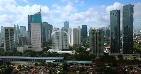 JAKARTA - Indonesia. March 01, 2018: Stunning aerial landscape of office buildings in Jakarta downtown. Recorded from flying drone. Shot in 4k resolution