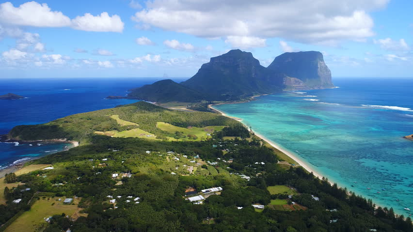 Aerial view of Lord Howe Island (World Heritage-listed paradise), turquoise blue lagoon and Mount Gower on background - New South Wales - Tasman Sea - Australia from above, 4k UHD | Shutterstock HD Video #1008187915