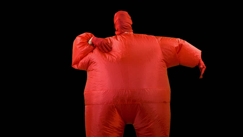 a man inside a red inflated fat suit dancing