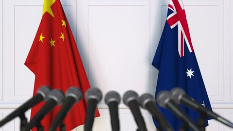 Flags of China and Australia at international meeting or negotiations press conference