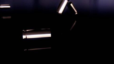 Animation depicting bullet casings hitting the floor in slow motion. 4K UHD.