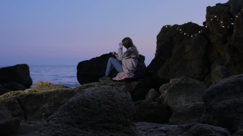 Beautiful Hipster Girl Drinks Tea\Coffee at the Evening Beach, Sea, Ocean, Sunset