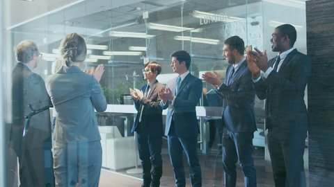 Successful Businessman Got Promotion and Makes Celebratory Dance, His Colleagues Applaud and Ecnourage Him. Shot on RED EPIC-W 8K Helium Cinema Camera.