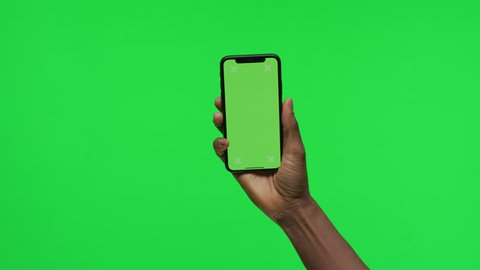 Female Hand holding Green Screen Smartphone