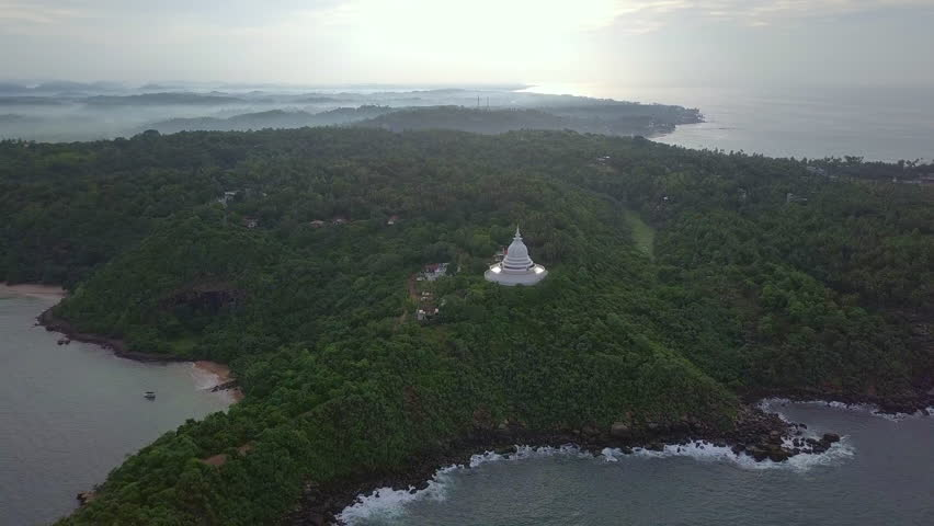 World Peace Pagoda in lush foggy forest at natural isalnd drone footage  | Shutterstock HD Video #1008268375