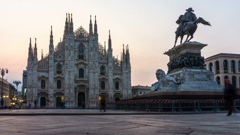 Sunset Time Lapse of Duomo di Milano or Milan Cathedral in city of Milan , Italy . Milan Cathedral is the largest church in Italy and the third largest in the world . Tourist attraction of Milan .