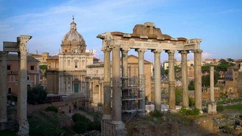 Roman Forum in Rome , Italy . Roman Forum was build in time of Ancient Rome as the site of triumphal processions and elections. It is famous tourist attraction of Rome , Italy .