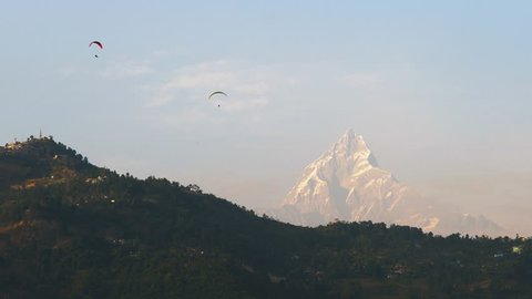 Paragliders with Annapurna and Machapuchare mountain in the background, Pokhara, Nepal, Asia.