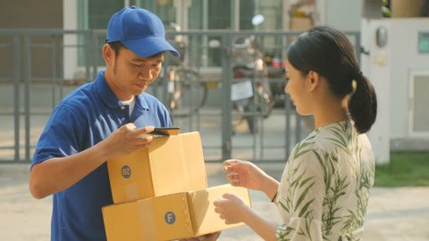 Smiling Delivery Man Comes To Delivers Packages.