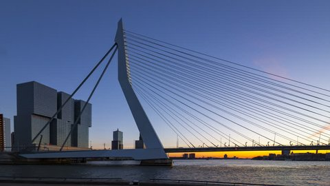 Sunset day-to-night static timelapse of the Rotterdam Erasmus bridge and the river Maas