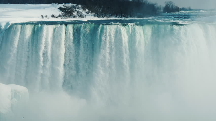 Wall from the water of the incredible Niagara Falls. Winter landscape in a popular tourist destination