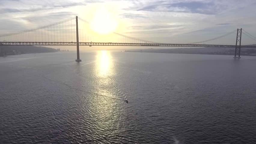 Aerial shot suspension Bridge 25 De Abril Over The Tagus River In Lisbon