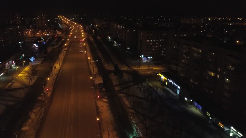 View from the height to the illuminated busy road and night city, multi-storey houses. Ukraine | Shutterstock HD Video #1008409705