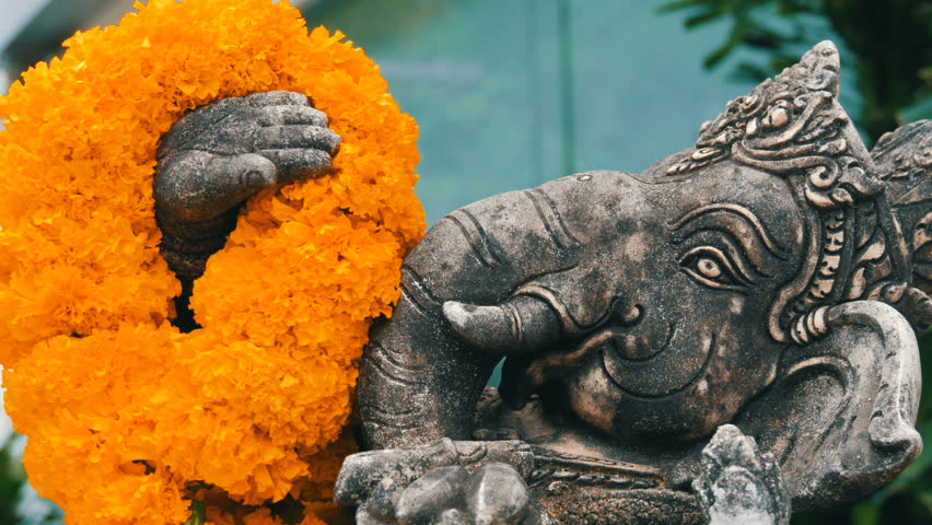Statue Of An Elephant In Flowers Close Up View Elephant Symbol Of