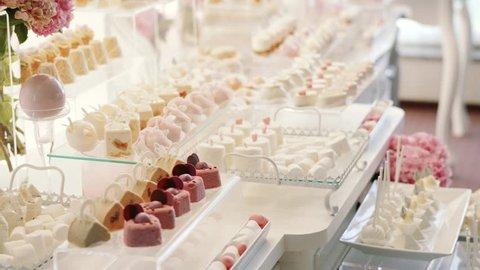 White Candy Bar Wedding, candy buffet. move camera closeup
