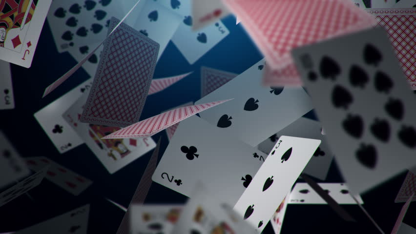 Animation falling playing cards and casino chips from light beams on dark shadow. Animation of seamless loop.